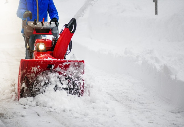 Man Using Snow Blower for Snow Removal in Peoria IL